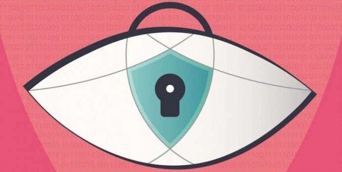 Oko z wydzieloną na jego środku tarczą i miejscem na klucz, na różowym tle