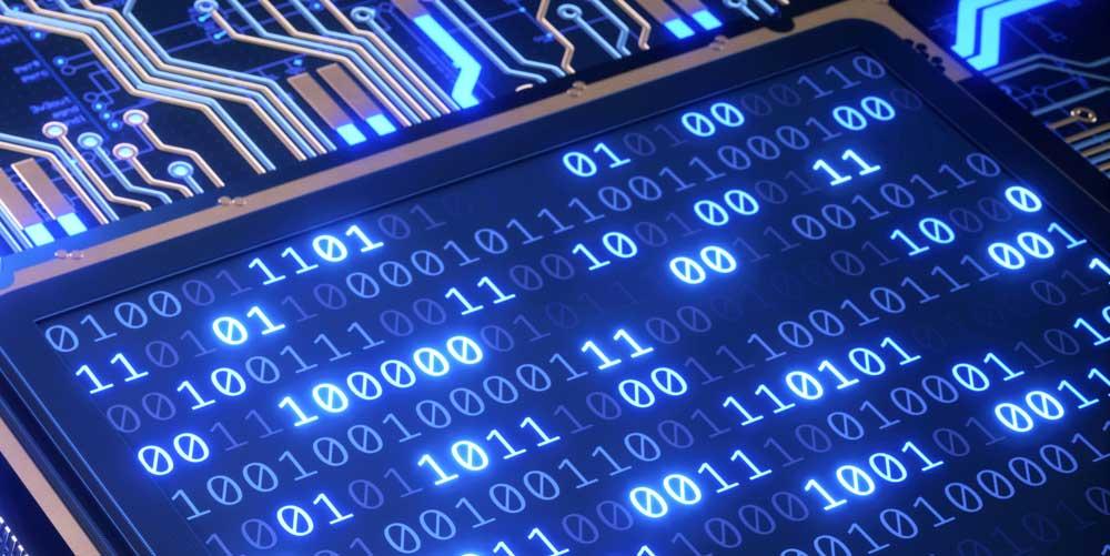 Ekran zapisany systemem dwójkowym imitujący procesor, od którego odchodzą obwody drukowane (tzw. Ścieżki)