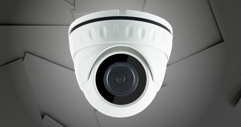 Biała kamera monitoringu na szarym tle